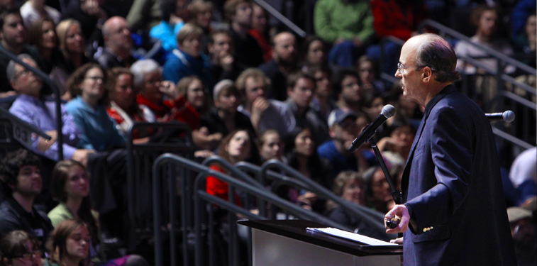 Tracey Kidder speaking to large crowd in Matthew Knight Arena.